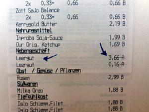 Recibo de caixa de supermercado, mostrando o desconto do Pfand.